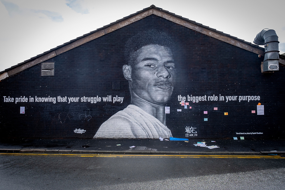 The Marcus Rashford mural displayed on the side of a cafe in Withington, south Manchester on the 6th of August 2021, Manchester, United Kingdom.  The mural has attracted huge numbers of people since the Euro 2020 final between England and Italy on 11 July and the subsequent racist abuse levied at Rashford and other Black players on the England team. Based on a photograph by Daniel Cheetham, the painting of Marcus Rashford was completed in 2020 by street artist Akse, in collaboration with the street art project Withington Walls, to commemorate the footballer's work to reduce child hunger. (photo by Andrew Aitchison / In pictures via Getty Images)
