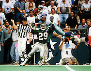 DALLAS TX-1994:  NFL receiver Alvin Harper of the Dallas Cowboys makes a spectacular catch versus the Philadelphia Eagles at Texas Stadium in Dallas Texas.  (Photo by Ron Vesely)..