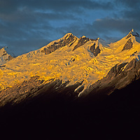A sunrise lights glaciers and summit crags on Nevado Sacsarayocin Peru's Cordillera Vilcabamba, a part of the Andes that is close to Macchu Picchu.  Due to climate change, these glaciers are shrinking every ytear.