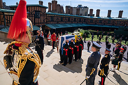 The Duke of Edinburgh's coffin, covered with his Personal Standard, is carried into St George's Chapel, Windsor Castle, Berkshire, ahead of the funeral of the Duke of Edinburgh. Picture date: Saturday April 17, 2021.