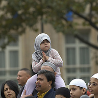 Young muslim girls wearing hijab, in the crow at  Eid in the Square,  Trafalgar Square,London, England<br />