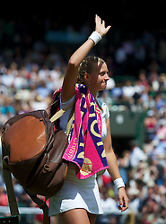 30.06.2012, Wimbledon, London, ENG, WTA Tour, The Championships Wimbledon, im Bild Petra Kvitova (CZE) waves to the crowd as she celebrates winning during the Ladies' Singles 3rd Round match during day six of the WTA Tour Wimbledon Lawn Tennis Championships at the All England Lawn Tennis and Croquet Club, London, Great Britain on 2012/06/30. EXPA Pictures © 2012, PhotoCredit: EXPA/ Propagandaphoto/ David Rawcliff..***** ATTENTION - OUT OF ENG, GBR, UK *****