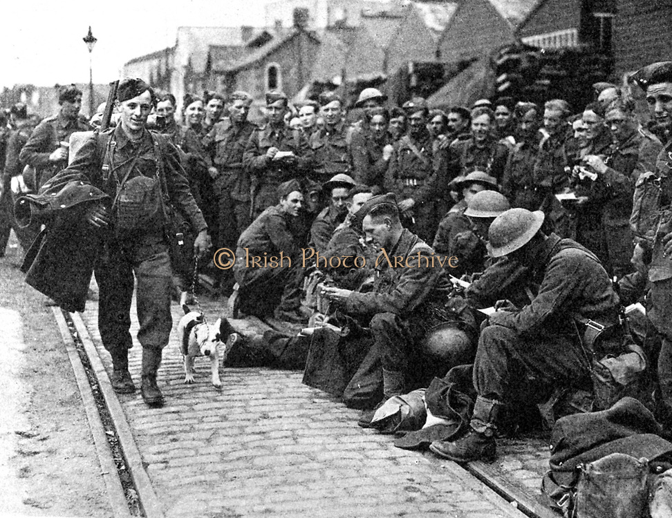 Members of the British Expeditionary Force evacuated from a port in north-western France after the Battle of France and the German advance, pleased to be on English soil again.