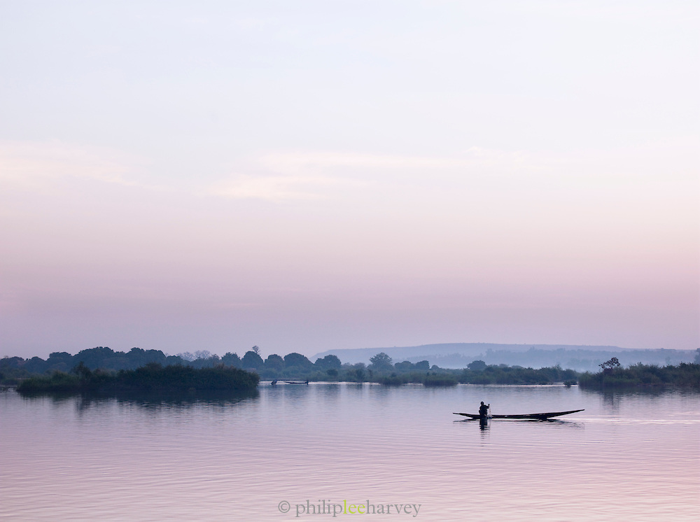 A small fishing boat on the Niger River, early in the morning in Bamako, Mali