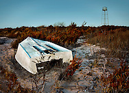 An old abandoned outboard boat near Sunset Beach in Cape May, New Jersey.
