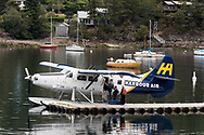 Passengers boarding a Harbour Air Seaplane (DHC-3 Turbine Single Otter) in Ganges Harbour on Salt Spring Island, British Columbia, Canada.