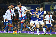 Connor Wickham of Crystal Palace looks to get away from Tom Cleverley of Everton. Barclays Premier league match, Everton v Crystal Palace at Goodison Park in Liverpool, Merseyside on Monday 7th December 2015.<br /> pic by Chris Stading, Andrew Orchard sports photography.