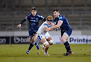 Sale Sharks Cameron Neild breaks past Bath Rugby's flanker Miles Reid during a Gallagher Premiership Round 9 Rugby Union match, Friday, Feb 12, 2021, in Leicester, United Kingdom. (Steve Flynn/Image of Sport)