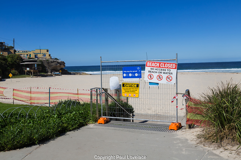 Sydney, Australia. Saturday 18th April 2020.Tamarama Beach in Sydney's eastern suburbs closed due to the Coronavirus Pandemic. From yesterday Tamarama beach was reopened for swimming and surfing. Waverley Council sign saying Beach Closed.