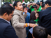 10 JANUARY 2015 - BANGKOK, THAILAND: General PRAYUTH CHAN-OCHA, the Prime Minister of Thailand, walks through the crowd during National Children's Day celebrations at Government House in Bangkok. National Children's Day falls on the second Saturday of the year. Thai government agencies sponsor child friendly events and the military usually opens army bases to children, who come to play on tanks and artillery pieces. This year Thai Prime Minister General Prayuth Chan-ocha, hosted several events at Government House, the Prime Minister's office.    PHOTO BY JACK KURTZ