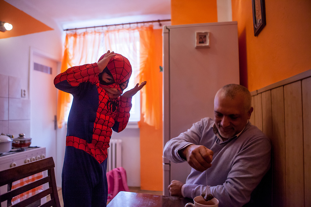 Visiting the family of Jitka Cervenakova (25) - the mother of Sarlota Kroscen (6) and Sebastian Kroscen (4), who is dressed as spiderman in that image. Jitka is also a volunteer supporting other mothers with knowledge and explaining legal rights for getting their children into mainstream schools in the city of Ostrava, where Roma and non Roma children are educated together. On the right Roma activist Miroslav Klempar.