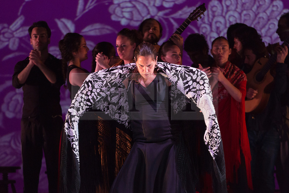 """© Licensed to London News Pictures. 20/02/2015. London, England. Pictured: artistic director Rafaela Carrasco performs in front of her troupe. Ballet Flamenco de Andalucía perform """"Las Cuatro Esquinas"""" from their production """"Images: 20 Years"""" during the Flamenco Festival London 2015 at Sadler's Wells Theatre. The show runs from 20-21 February with the festival running from 16 February to 1 March 2015.  Photo credit: Bettina Strenske/LNP"""