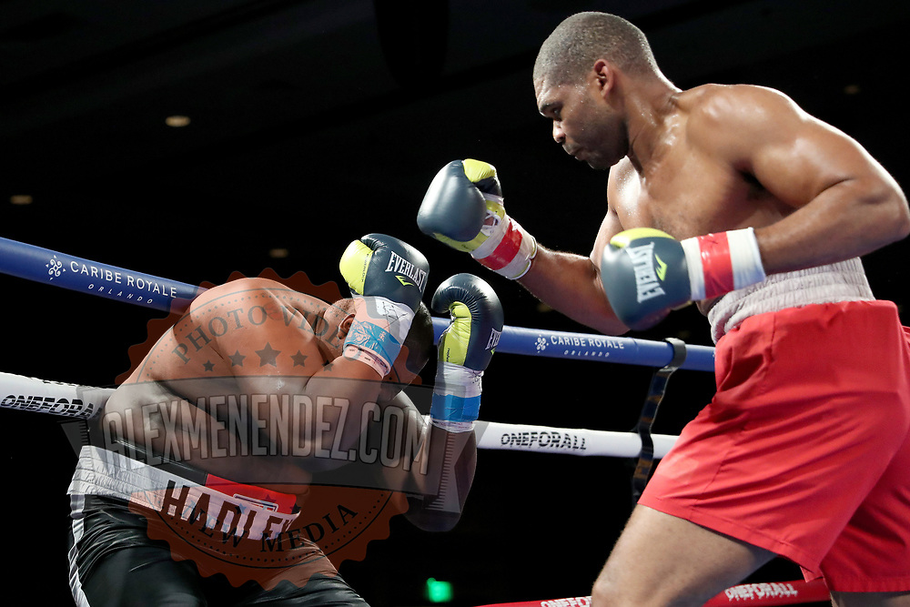 Brandon Lynch (R) fights Vincent Hadley during a One For All Promotions boxing event at the Caribe Royale Orlando Events Center on Saturday, February 20, 2021 in Orlando, Florida. (Alex Menendez via AP)