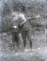 Boys with slingshots early 1900's