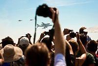 The crowd takes pictures of the Shuttle Endeavor as it flies over Los Angeles, CA.  September 21,  2012. Photo by David Sprague