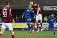 AFC Wimbledon striker Joe Pigott (39) battles for possession with Northampton Town defender Ash Taylor (6) during the EFL Sky Bet League 1 match between AFC Wimbledon and Northampton Town at the Cherry Red Records Stadium, Kingston, England on 10 February 2018. Picture by Matthew Redman.