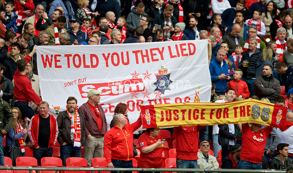 LONDON, ENGLAND - Sunday, April 19, 2015: Liverpool supporters' banner 'We told you they lied' before the FA Cup Semi-Final match against Aston Villa at Wembley Stadium. (Pic by David Rawcliffe/Propaganda)