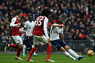 Harry Kane of Tottenham Hotspur (R) delivers a cross into the box. Premier league match, Tottenham Hotspur v Arsenal at Wembley Stadium in London on Saturday 10th February 2018.<br /> pic by Steffan Bowen, Andrew Orchard sports photography.