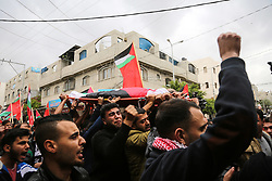 April 26, 2018 - Jabaliya, Gaza strip, Gaza - Palestinian mourners carry the body of Palestinian journalist Ahmed Abu Hussein at a hospital in Jabalia camp , in the northern of Gaza Strip, who was shot two weeks ago by Israeli forces as he was covering demonstrations on the Gaza border. (Credit Image: © Nidal Alwaheidi/Pacific Press via ZUMA Wire)