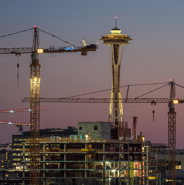 Construction cranes in Seattle, 07/25/2018, working in the South Lake Union neighborhood, in the vicinity where a crane fell Saturday 4/28/2019, killing four people. Crane arms display markings from GLY Construction and Morrow Equipment, two of the companies under investigation in the incident. Space Needle in the distance. 07/25/2018.  Unknown whether crane that fell is pictured.