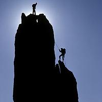 ROCK CLIMBING. Bela & Mimi Vadasz rappel on Eichorn's Pinnacle, Cathedral Peak, Yosemite Nat. Park, CA (Sierra Nevada)  (MR)