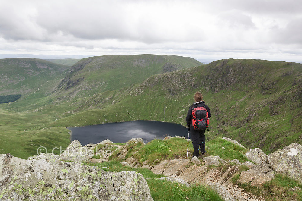 Walker looking at view over Blea Water from Rough Crag