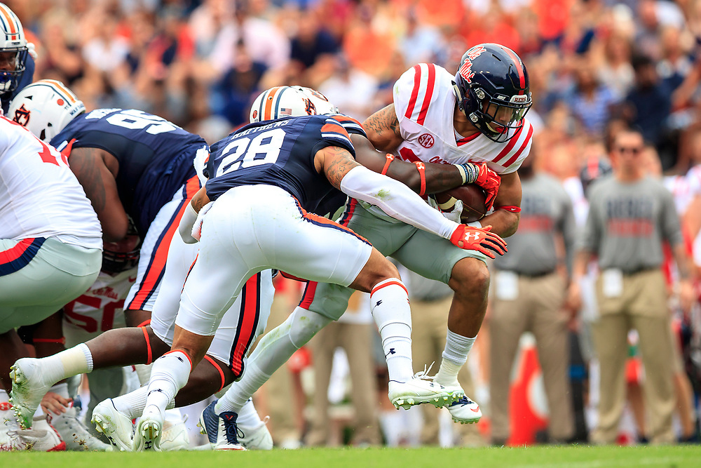 Mississippi Rebels running back Jordan Wilkins (22) carries the ball against Auburn Tigers defensive back Tray Matthews (28) during an NCAA football game, Saturday, October 7, 2017, in Auburn, AL. Auburn won 44-23. (Paul Abell via Abell Images for Chick-fil-A Peach Bowl)