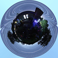 Backyard Late Summer Nighttime Sky Over New Jersey. Little Planet 360 degree Panorama. Composite of 360 (jpg) images taken with a Ricoh Theta Z1 360 camera (ISO 400, 2.6 mm, f/2.1, 60 sec). Star Trail composite and Little Planet view created with PhotoShop CC (scripts, statistics, maximum), (image size 1:1, image rotated 180 degrees, filter, distort, polar coordinates).