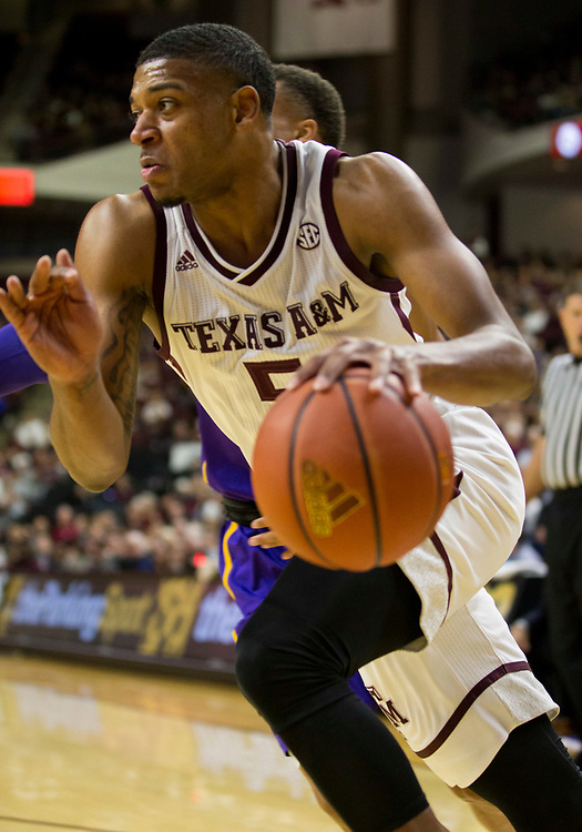 Texas A&M guard Savion Flagg (5) drives the baseline against LSU during the first half of an NCAA college basketball game Saturday, Jan. 6, 2018, in College Station, Texas. (AP Photo/Sam Craft)