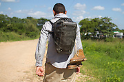 """""""Yoel"""", Honduran migrant, 18, walks in Tenosique, Tabasco on October 14th, 2012.  Mothers of central american migrants from Honduras, El Salvador, Guatemala and Nicaragua (claimed as disappeared in Mexico) will travel on a caravan from October 15t through 23 locations in 14 mexican states during 20 days. (Photo: Prometeo Lucero)"""