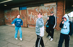 Children hanging out on a Bradford council estate; UK