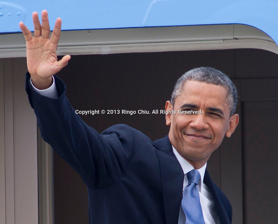 President Barack Obama waves as he boards Air Force One from Los Angeles International Airport  in Los Angeles, Friday, June 7, 2013., to Palms Springs to meet with the Chinese President Xi Jinping for two days of talks on high-stakes issues, including cybersecurity and North Korea's nuclear threats. (Photo by Ringo Chiu/PHOTOFORMULA.com)