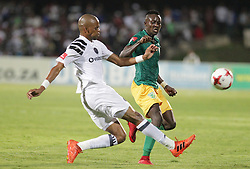 17032018 (Durban) Luvuyo Memela of pirates and Nkombelo Zolani of Arrows tackle when Orlando Pirates walloped Golden Arrows 2-1 at the ABSA premier league encounter at Princess Magogo Staduim, in Kwa-Mashu, Durban. Pirates has advance their league position to number 2 with 41 points after Sundowns with 42 points lead.<br /> Picture: Motshwari Mofokeng/African New Agency/ANA