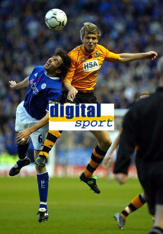 Photograph: Scott Heavey.<br />Leicester City v Blackburn Rovers. FA Barclaycard Premiership. 02/11/2003.<br />Muzzy Izzet collides with Vratislav Gresko (Right)