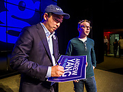 28 APRIL 2019 - DES MOINES, IOWA: ANDREW YANG, left, autographs a yard sign for a supporter after a Town Hall event in Des Moines. Yang, an entrepreneur, is one of 20 Democrats running for the Democratic nomination for the US Presidency in 2020. Iowa hosts the the first election event of the presidential election cycle. The Iowa Caucuses will be on Feb. 3, 2020.                 PHOTO BY JACK KURTZ