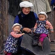 China, People, Tibetan farmers, Grandma holding twin grand- Children Sichuan, China.