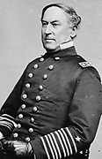 David Glasgow Farragut (1801–1870) officer of the United States Navy during the American Civil War 1861-1865.  First rear admiral, vice admiral, and full admiral of the Navy.  Three-quarter length portrait, seated.
