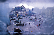 A view of Bucharest's central Square surrounded by tanks and bombed out buldings after the Romanian revolution ousted the dictator Ceucescu from power over Christmas of 1989.