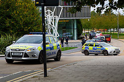 © Licensed to London News Pictures. 08/10/2016. London, UK. Police officers patrol on Hornsey High Street and New River Avenue in north London after a man in his 20s was found with a gunshot wound in the scene last night and six women have been arrested as part of the investigation on 8 October 2016. Photo credit: Tolga Akmen/LNP