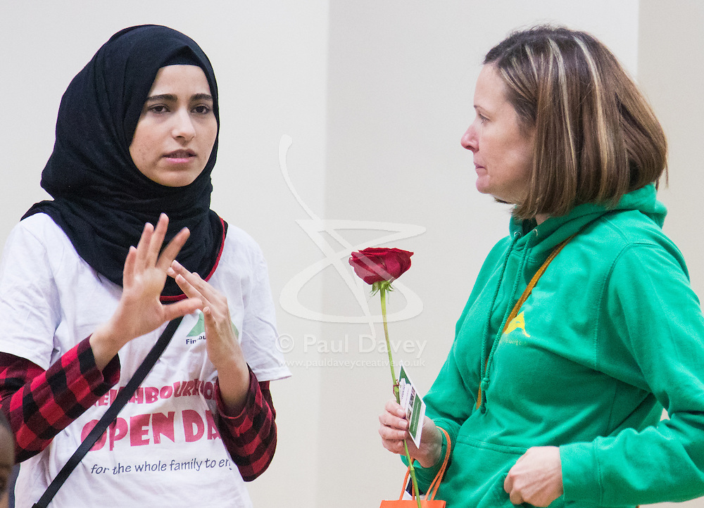 """Finsbury Park Mosque, London, February 7th 2016. A Mosque guide explains to a local non-Muslim resident the workings of the mosque as part of a Visit My Mosque initiative by the Muslim Council of Britain to show non-Muslims """"how Muslims connect to God, connect to communities and to neighbours around them"""".<br /> . ///FOR LICENCING CONTACT: paul@pauldaveycreative.co.uk TEL:+44 (0) 7966 016 296 or +44 (0) 20 8969 6875. ©2015 Paul R Davey. All rights reserved."""