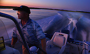 A Motorboat Pilot at Dusk, Delaware Bay, Newport, South Jersey, NJ