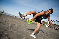 Jamie Chantiles plays freestyle frisbee on La Jolla Shores Beach on December 19. San Diego tied a record high temperature of 80 degrees on the same day a freezing storm hit much of the East Coast.