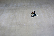 Two young women sketch on the large floor area of the Turbine Hall at Tate Modern on the Southbank, on 14th May 2017, in London, England.