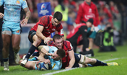 Exeter Chiefs's Henry Slade is knocked into touch by Munster's Tommy O'Donnell during the Heineken European Challenge Cup, pool two match at Thomond Park, Limerick.