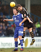 Picture: Henry Browne.<br /> Date: 26/02/2005.<br /> Gillingham v Wigan Athletic Coca Cola Championship.<br /> Michael Flynn of Gills is beaten in the air by Wigan's Ian Breckin.