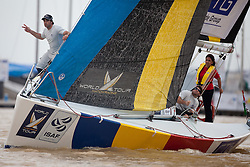Bowman calling the distance to the line, French Match Racing Team, Monsoon Cup 2009. Kuala Terengganu, Malaysia. 3 December 2009. Photo: Sander van der Borch / Subzero Images