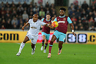 Alex Song of West Ham Utd ® is challenged by Andre Ayew of Swansea city (l). Barclays Premier league match, Swansea city v West Ham Utd at the Liberty Stadium in Swansea, South Wales  on Sunday 20th December 2015.<br /> pic by  Andrew Orchard, Andrew Orchard sports photography.
