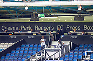 Journalists in the Queens Park Rangers Press Box, face masks, during the EFL Sky Bet Championship match between Queens Park Rangers and Barnsley at the Kiyan Prince Foundation Stadium, London, England on 20 June 2020.