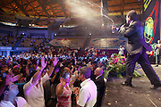 The apostle Jorge Tadeu, leader of the Mana Church, throws a so-called holy water over the believers. During the faith convention they pray, dance, sing and wait for a miracle to change their lives.