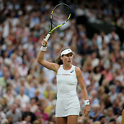 LONDON, ENGLAND - JULY 11:  Johanna Konta of Great Britain in action against Simona Halep of Romania in the Ladies' Singles Quarter Final match on Center Court during the Wimbledon Lawn Tennis Championships at the All England Lawn Tennis and Croquet Club at Wimbledon on July 11, 2017 in London, England. (Photo by Tim Clayton/Corbis via Getty Images)